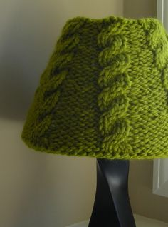 Cable knit lampshade: not crazy about the color, but great way to recycle an old sweater with a little spray glue :)