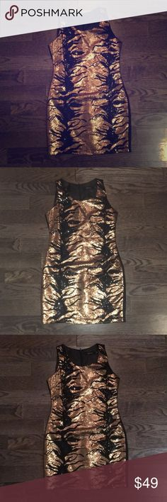 Bloomingdales Shift Dress. Perfect condition! Purchased from Bloomingdales. Never worn, this only sat in my closet :( I debated wearing this last New Years.  Back zipper.  Fully lined.  Hand wash only! Black and bronze. Dresses Mini
