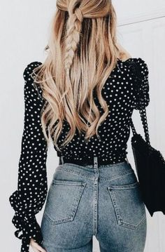 Black and white polka dot blouse with high waisted jeans.