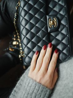 Chanel boy bag with red nails and a grey sweater. So holiday chic.
