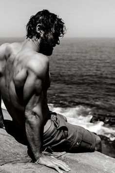such a masculine feel to this photo. muscles, shade, waves.