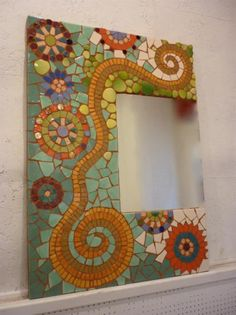 Mosaic mirror frame with swirl and circle pattern looks great! Mosaic Artwork, Mosaic Wall Art, Mirror Mosaic, Mirror Art, Mosaic Glass, Glass Art, Mosaic Crafts, Mosaic Projects, Mosaic Designs