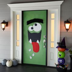 Nothing scary about this goofy DIY Halloween Door Decor Monster. Trick-or-treaters and other guests are sure to be delighted with your display