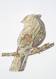 Intricate Paper Map Cutouts of Nature by Claire Brewster.