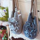 This blog is a woman who is supertalented at creating upcycled items from felted wool sweater... she does purses, and little wristlet and girls purses, but also gorgeous large snuggly sweater flower pillows... she makes other things too!!! All very creative and so pretty!!!