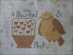 Bushel & A Peck is the title of this cross stitch pattern from Not Forgotten Farm.