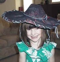 sombrero from newspaper. Great painting and pre-sewing/lacing activity.