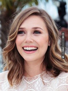 """SOFT AND WAVY """"Elizabeth Olsen's cut is the same as Dakota Fanning's, just styled differently,"""" Buckett says. To get waves, apply mousse to damp hair, blow-dry, then curl random pieces. ALLURE TIP: This length also plays well with every hair texture. It's long enough to weigh down thick hair but won't make fine hair look wimpy."""