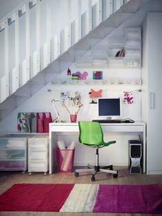 Great solution for a nice home office if lack of space - make use of the room under the stairs. Here decorated with simple furniture together with colourful elements to give the space some personality.