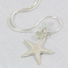 "Cast from the real thing, this delicate sterling silver starfish pendant on a fine silver snake chain. Finished off with aquamarine and prehnite beads.  Sterling silver and aquamarine prehniteStarfish 18 x 18mm. Snake Chain 40cm (16"")."