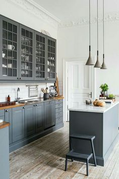Cabinet color, counter tops (maybe flipped between wall and island)