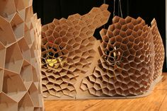 Lightweight Structures and Conceptual Design (ILEK)  University of Stuttgart. Under the direction of Prof. Dr.-Ing. Werner Sobek  they have created an exhibition stand out of and irregular honeycomb structure that will exhibit objects by five young designers presented by Magazin and Süddeutsche Zeitung Magazin. The screens are made up of 3mm and 10mm MDF, that has been CNC-cut into 2,142 pieces joined by 1,376 unique pairs of connecting components that are slotted together without adhesive.