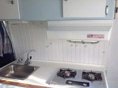 Purple wainscoting boler kitchen.