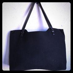 """Banana Republic Black Wool Handbag Banana Republic Black Wool Handbag. Leather straps. Three compartment and interior phone pocket. 15"""" wide x 11.5"""" high x 4"""" deep. Blue lining. Small interior marks reflected in price. Banana Republic Bags Totes"""