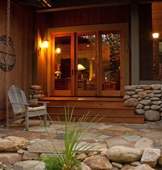 The rugged stone and natural wood of this sheltered entry invite you in...