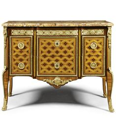 A fine tulipwood stained sycamore, amaranth and parquetry commode attributed to Pierre Roussel Louis XV/XVI Transitional, ca 1765 Estimate 15,000 — 25,000 GBP