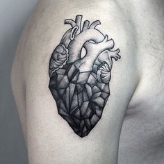 Geometric heart shoulder tattoo.