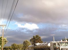 i liked how that one white cloud is surrounded by gray clouds