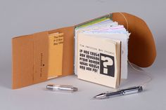 I like books with pockets and little hide-aways. By Carol Lynn Mitchell, USA.   MIMB II by mimb.org Monumental Ideas in Miniature Book, via Flickr