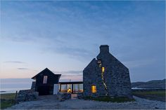 Modern Home built within a 150 year-old Abandoned Farmhouse. On the tiny wind-lashed Isle of Coll in northwest Scotland, a modern five-bedroom farmhouse has risen from the ruins of a local landmark known as the White House, built in the mid-1700s.