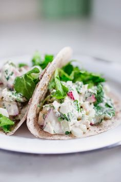 Kicked-up Tuna Salad with jalapeño, cilantro and radish and cucumber. Full of healthy veggies! Stuff a pita, or tortilla or an avocado!! Can be made in 7 minutes flat! #tunasalad #gluten free