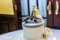 Love this custom cake topper! The groom was an Air Force pilot. www.photosbyrb.com