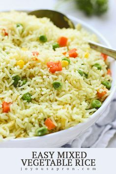Easy Mixed Vegetable Rice - a quick, easy AND flavorful comfort food side! Basmati rice cooked in garlic and chicken bouillon and tossed with mixed vegetables. Yummy, light and healthy - a fantastic freezer friendly and meal prep recipe as well! Vegetable Rice, Vegetable Recipes, Vegetarian Recipes, Cooking Recipes, Healthy Recipes, Vegetable Planters, Healthy Rice, Cooking Rice, Veggie Food