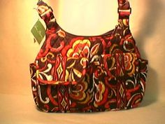 Vera Bradley Cargo Sling in Puccini.  Great crossbody hobo hipster swing bag purse. Full zip pocket across back.  Front flap pockets secure and easy to access without taking bag off shoulder.  NWT Retired