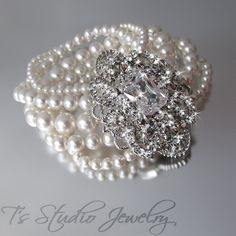 Pearl Bridal Bracelet, Multi Strand Cuff with Rhinestone Brooch, Wedding Jewelry - CAMILLE. $88.00, via Etsy.