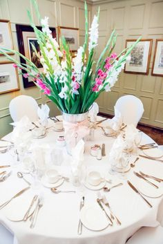 Beautiful table with gladiolus centerpiece