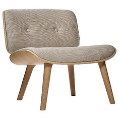 You will feel more than safe relaxing in the Moooi Nut Lounge Chair. The chair gets its sense of protective comfort from its oak veneer seat and back, which curve upward and inward, respectively, to create a warm, nest-like embrace. Customize to your taste and living space with a variety of different upholstery fabrics.