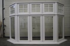 large Casement Bay Window finished in white gloss. Dormer Windows, Sash Windows, House Windows, Windows And Doors, Edwardian House, 1930s House, Bay Window Exterior, Bay Window Living Room, Craftsman Exterior
