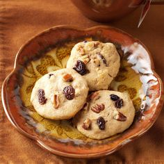 Raisin Sweet Potato Cookies Recipe -Cozy up to the fire with a plate of satisfyingly sweet cookies that taste like home. Serve the treats with a mug of hot chai tea or ice-cold milk, and no one will be able to resist them. —Jacque Sue Meyer, Lohman, Missouri