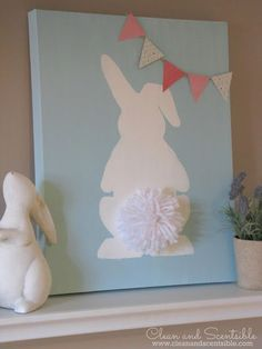 Put bunny stencil on a canvas, paint canvas blue, take off stencil, add white pompom tail and scrapbook paper banner!