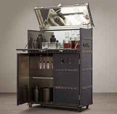 Storage Furniture - This bar cabinet is solidly built, clad in leather and edged all around with scores of brass nailheads hammered by hand. Home Bar Decor, Bar Cart Decor, Furniture Restoration, Restoration Hardware, Black Bar Cart, Bar Antique, Bar Trolley, Bar Unit, Portable Bar