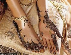 mehendi or henna used to ornate the body of the bride