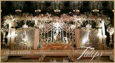 Glorify Pakistani wedding with crystal gate stage design concept. Fantastic approach to gate style wedding stage decoration perks.  #crystalweddings #weddinggate #gatestylestage #pakistaniweddinggate #tulipsevents #weddingsinpakistan #themedweddings #weddinggateflowering  Designed and arranged by: Tulips Creative Team