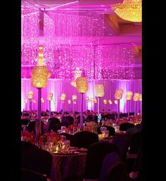 Unlike covering your wedding venue with towering floral arrangements, creative lighting can be surprisingly affordable. From uplighting to lanterns, imag...