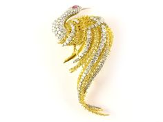 Yellow and white gold swan shaped brooch with diamonds diamanti ct 3,50 circa, g 41,1 Estimation : 1.900/2.000€ MAISON BIBELOT, MILANO