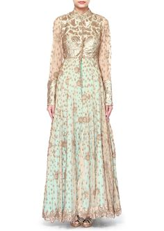 Beige anarkali suit featuring in net. Its comes with front slit embellished in sequin embroidery over. Matched with straight pant in blue raw silk. Slight variation in color is possible. 95% of our customers believe that the product is as shown on the website.