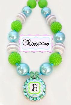 Chunky necklace via Etsy, lime green, light turquoise, gray stripe, love how the bottlecap has added bling!