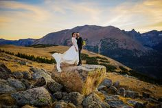 A wedding couple watch the sun set on Ute Trail in RMNP