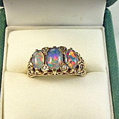 Rose Gold, Opal and Diamond Bridge Ring. Click on the image for more information.