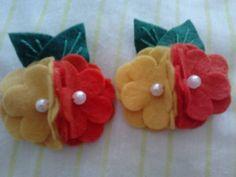 bico de pato com flores de feltro,vendido como par.cores sob consulta. R$ 10,00