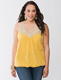 Our soft, knit tank goes glamorous with a shimmering crochet neckline embellished with sequin accents. Versatile for dressy or casual looks, this flattering tank offers a gorgeous shape with its scoop neckline and elastic bubble hem. Looks great layered, too! lanebryant.com