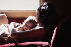 Baby in mothers arms. Window.  Light. Sensual. Feelings. Tender. Love.