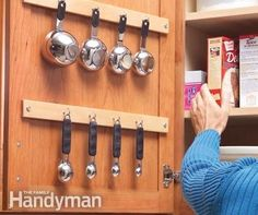 11 fun and creative ways to hang cooking utensils in a small kitchen: Inside a cupboard