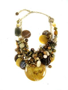 SKU: 7228. Categories: Necklaces, One of a Kind. Tags: beige, brass, Brown, copper, hand beaded, ivory, mother of pearl, necklace, one of a ...