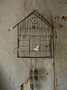 wire cuckoo clock!  What?!  I got a wire birdhouse looking thing at the thrift store and NOW I have a project for it!  :)
