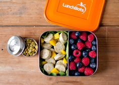 Paleo school lunch with chicken sausage and yellow peppers, blueberries, and raspberries in the LunchBots Duo. Roasted pumpkin seeds in the LunchBots Dip.